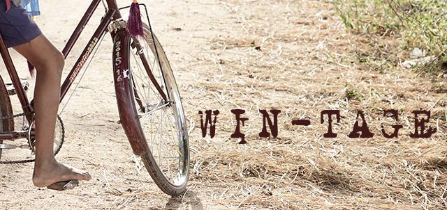"""Foto bambino in bici con scritta """"Win-tage"""""""